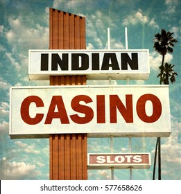 aged and worn vintage photo of Indian casino sign with palm trees