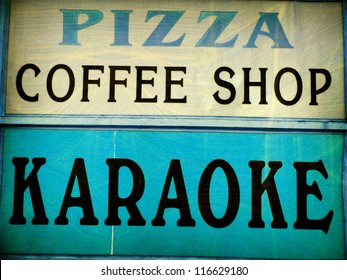 aged and worn vintage photo of  karaoke and pizza sign