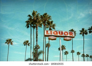 aged and worn vintage photo of liquor and groceries store sign with palm trees
