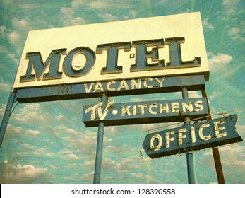 aged and worn vintage photo of neon motel sign