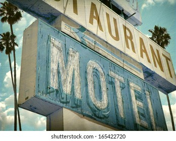 aged and worn vintage photo of neon sign with palm trees