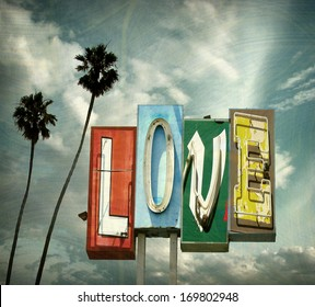 aged and worn vintage photo of  neon love sign with palm trees