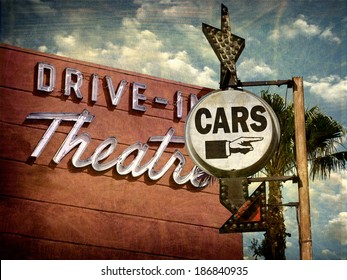 aged and worn vintage photo of neon drive in sign