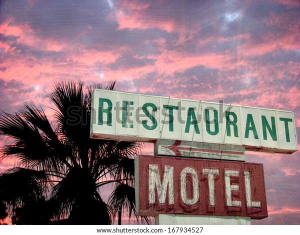 aged and worn vintage photo of neon sign at sunset
