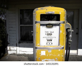 aged and worn vintage photo of old gas pump