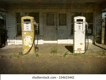 aged and worn vintage photo of old gas station with pumps