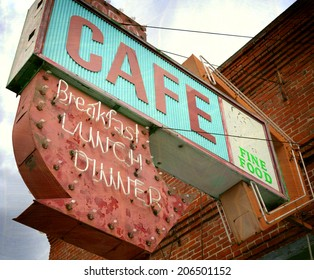 aged and worn vintage photo of old neon cafe sign