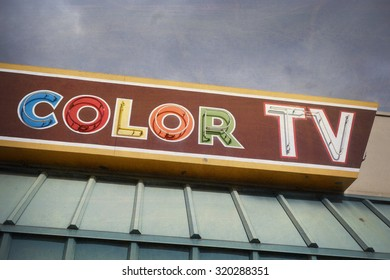 aged and worn vintage photo of retro color television sign