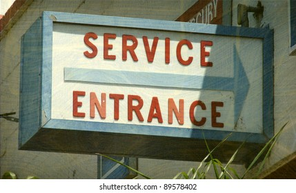 aged and worn vintage photo of service entrance sign