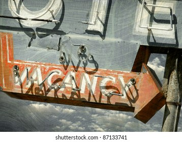 aged and worn vintage vacancy sign