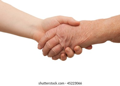 Ageing - handshake between young and old women on white background