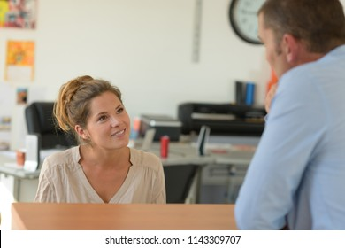 agency receptionist helping a client