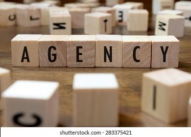agency word written on wood block