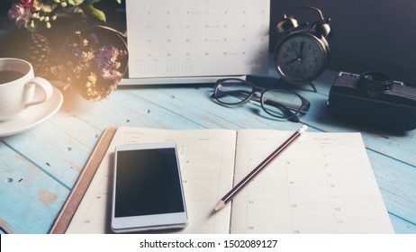 Agenda book and mobile phone for Planner to plan timetable appointment organization management each date month and year, working online at home. Agenda and  2021 Calendar Concept.