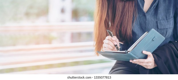 Agenda of planner woman schedule and organize appointment 2019 Calendar Event. Smart Business woman note and schedule to set timetable organize schedule. Woman hands writing on Agenda.Timeline concept