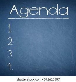 Agenda text written on a blackboard