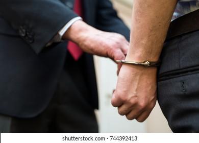 Agent arresting a businessman