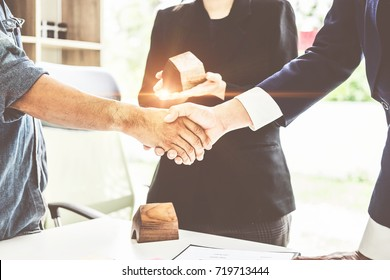 Agent and customer meeting and handshaking after good deal for buy house. Agreement and Real estate concept.