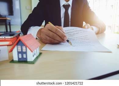 Agent give agreement contract document to customer. Property and Real Estate concept.