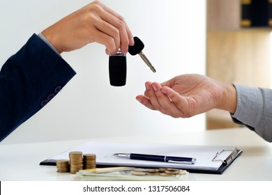 agent giving a car vehicle key to customer, business and transportation.
