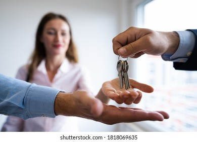 Agent Giving Home Keys To Couple. Closing Sale