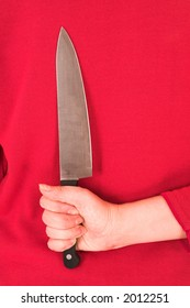Aggravated wife with knife behind her back