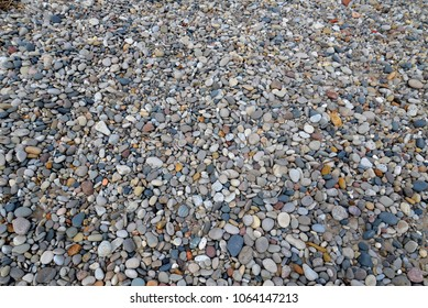 Aggregate background from Lake Michigan shoreline showing multiple colors and sizes of the worn stones.  Use as a tileable pattern backdrop.