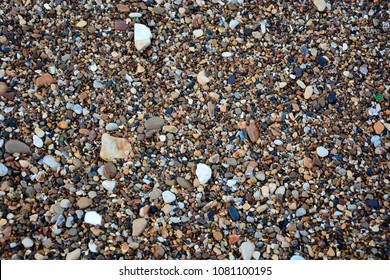 Aggregates along the shore of Lake Michigan on the Wisconsin side of the Great Lake.  A small colourful mixture of wet aggregate.  Seamless tileable background.