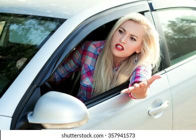 Aggression, she screams driving the car