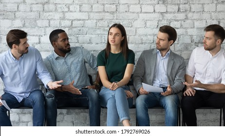 Aggressive annoyed diverse men looking at confident woman, sitting in queue in row, candidates applicants waiting for job interview, professional inequality, gender discrimination concept