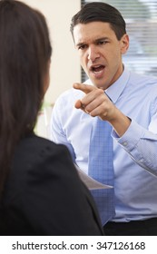Aggressive Businessman Shouting At Female Colleague