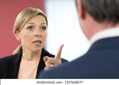 Aggressive Businesswoman Shouting At Male Colleague