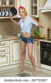 aggressive cook in a pan, on the background of the kitchen