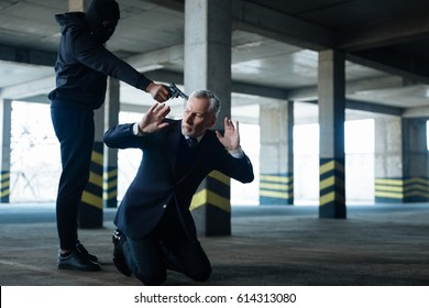 Aggressive dangerous criminal abducting a businessman