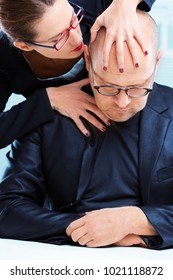 Aggressive dominant woman tormenting man at workplace