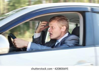 Aggressive driver behind the wheel of a car