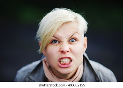 Aggressive girl showing rage and anger