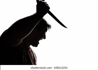 An aggressive man attacks with a knife. Stabbing attack. Hand with a knife. Murder with a knife.