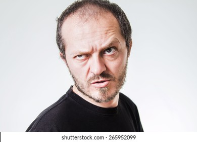 Aggressive man with beard and mustaches, threatening