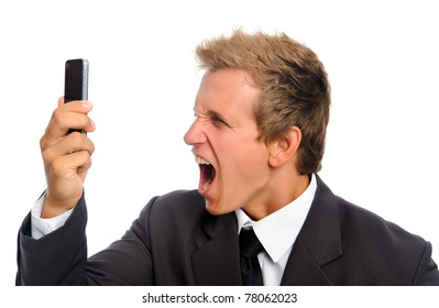 Aggressive man in business suit shouting into his mobile phone