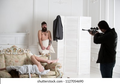 Aggressive man with gun to shoot couple in love. Husband arrived home to see wife cheat with lover. Hipster shocked to see gunman in bedroom. Cheating, jealousy and violence. Love triangle concept.