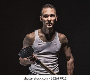 Aggressive muscular man with hammer