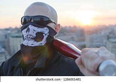 Aggressive skinhead, ultras, skipped gopnik. The psycho threat of danger from psychos. Bat, bone, knife threatening. Angry furious guy. Rage man. Hooligan, gangster, criminal, threatens. Military boy
