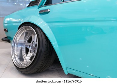Aggressive Wheel Offset in a retcar. Hella Flush is Wheel offset, Small stretched tires, on a slammed vehicle = flush, or hella flush as people like to say. Rims with a lot of offset.