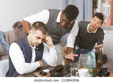 Aggrieved man dont speaking with two friends during quarrel at home