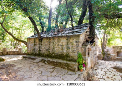 Agia Theodora church in Isaris Peloponnese, Greece. On the roof of the church have grown giant trees without any roots inside.