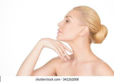 Aging gracefully. Closeup profile of a beautiful mature woman touching her neck