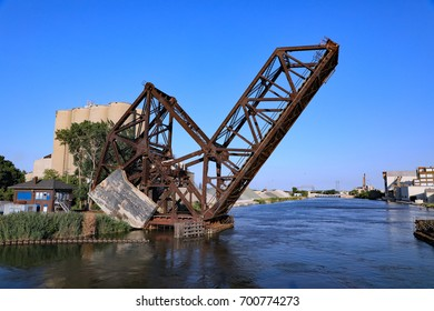 An aging railroad draw bridge over the Rouge River, south of Detroit, Michigan, with an enormous counterweight.