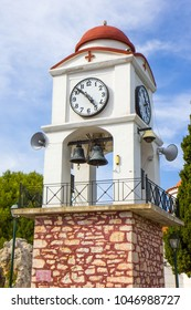 Agios Nikolaos church with clock tower on the Skiathos island, Greece