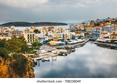Agios Nikolaos, Crete, Greece - June 07, 2017: Agios Nikolaos town at summer evening. Agios Nikolaos is one of the most touristic cities on Crete island, Greece
